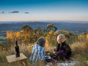 elderly-couple-having-picnic-overlooking-hinterland-mount-mee-daguilar-national-park-samford